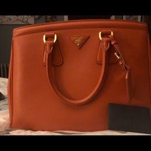 Prada Saffiano Lux papaya orange handbag